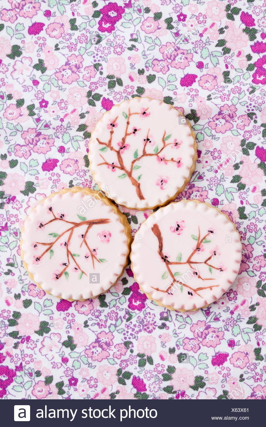 Painted pink sugar cookies, close up - Stock Image