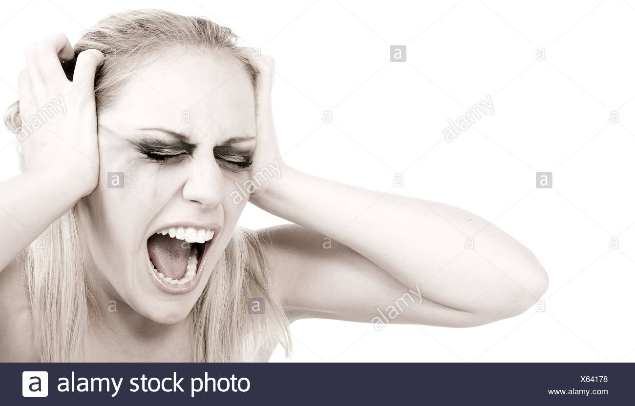 Studio portrait of a young blond woman in despair - Stock Image
