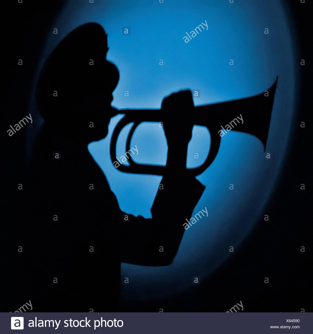 Shadow of Airman Playing Bugle - Stock Image
