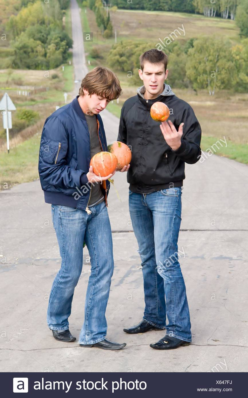 dudes with pumpkins - Stock Image