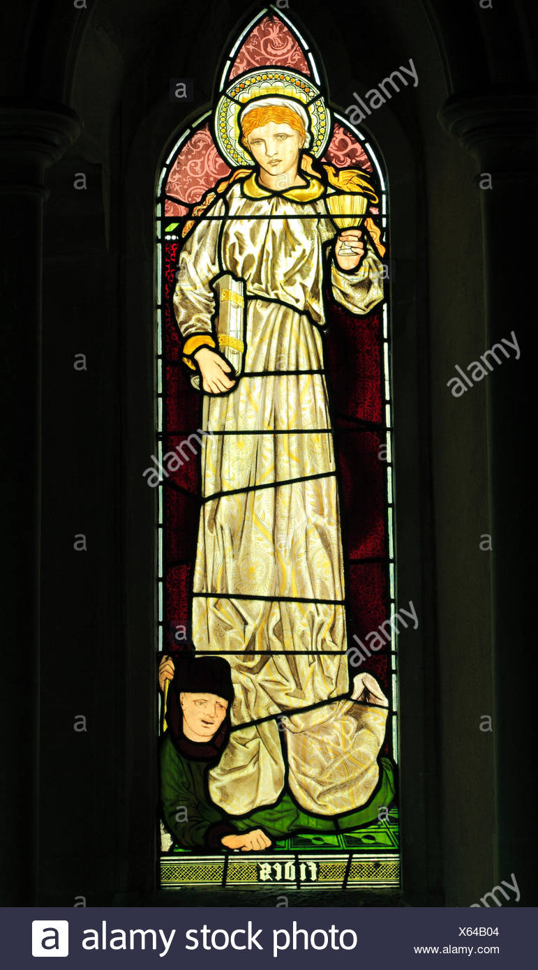 Fides, Faith, stained glass window by Burne-Jones, 1865, detail from Faith Hope and Charity' window, Sculthorpe church, Norfolk, England UK - Stock Image
