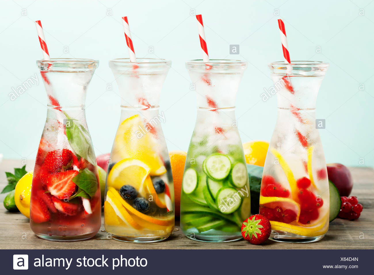 Detox fruit infused flavored water. Refreshing summer homemade cocktail - Stock Image