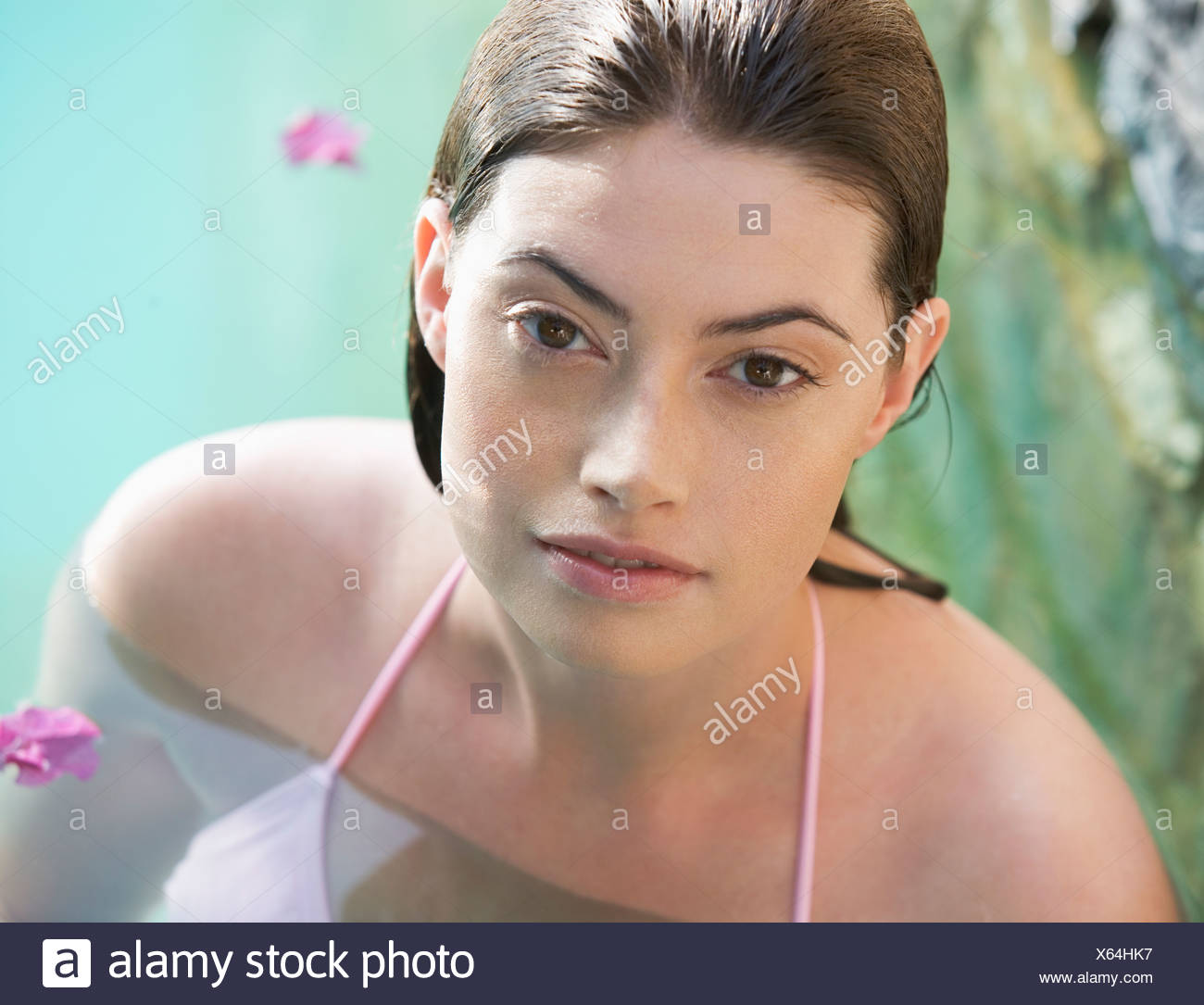 A woman wearing a bikini in a pool - Stock Image