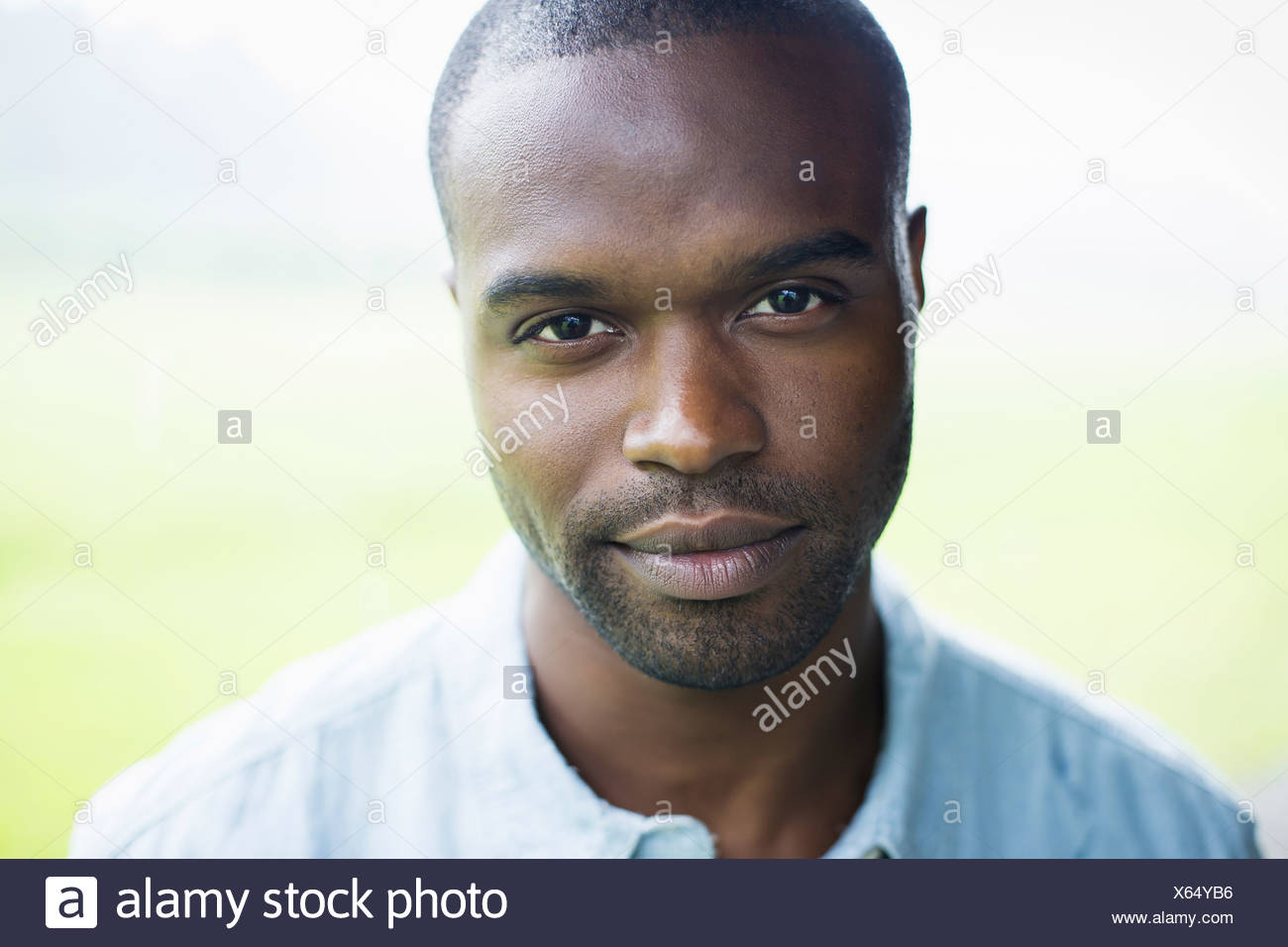 A young man in a blue shirt. - Stock Image