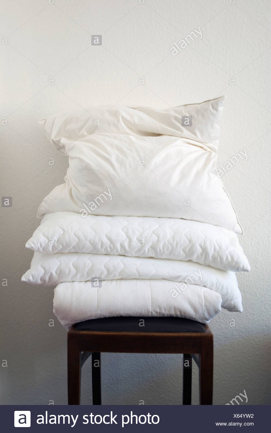 Bedding on chair - Stock Image