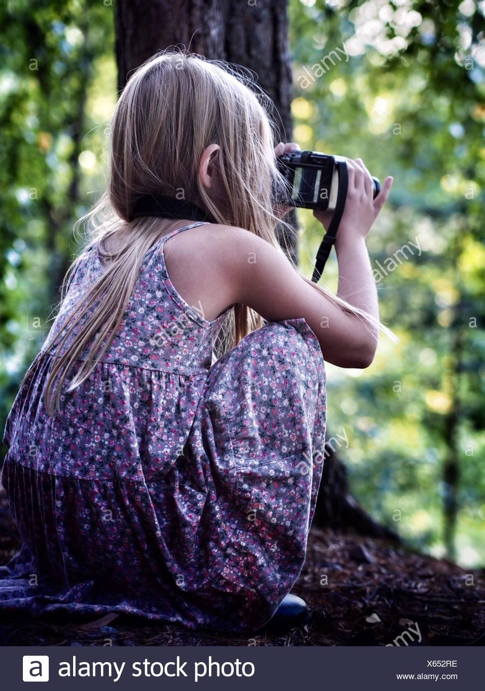 Sweden, (8-9 years) Girl taking photo - Stock Image