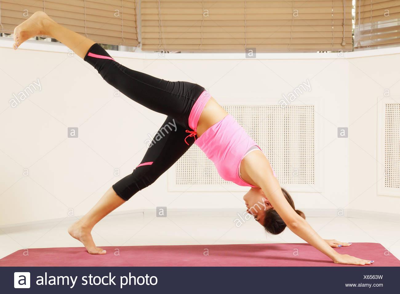 Yoga pose one leg up Stock Photo - Alamy