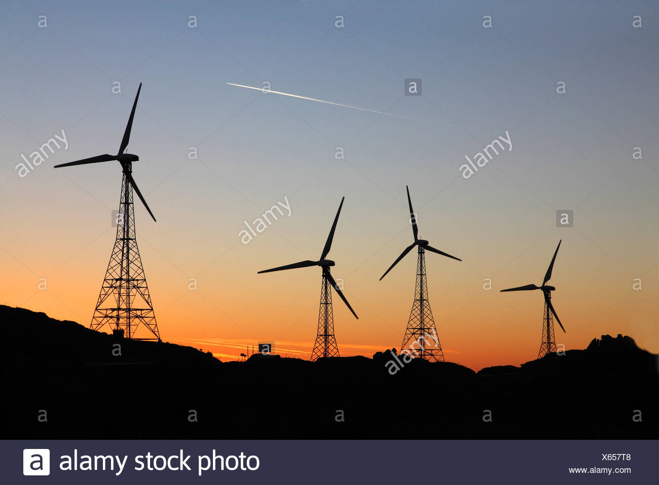 wind engines at sunset, Spain, Andalusia, Tarifa - Stock Image