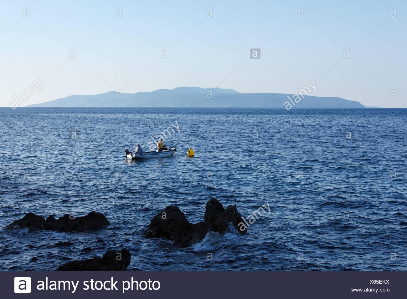 Fishermen in a boat, Cres Island, view from Ika, Istria, Kvarner Gulf, Croatia, Europe Stock Photo
