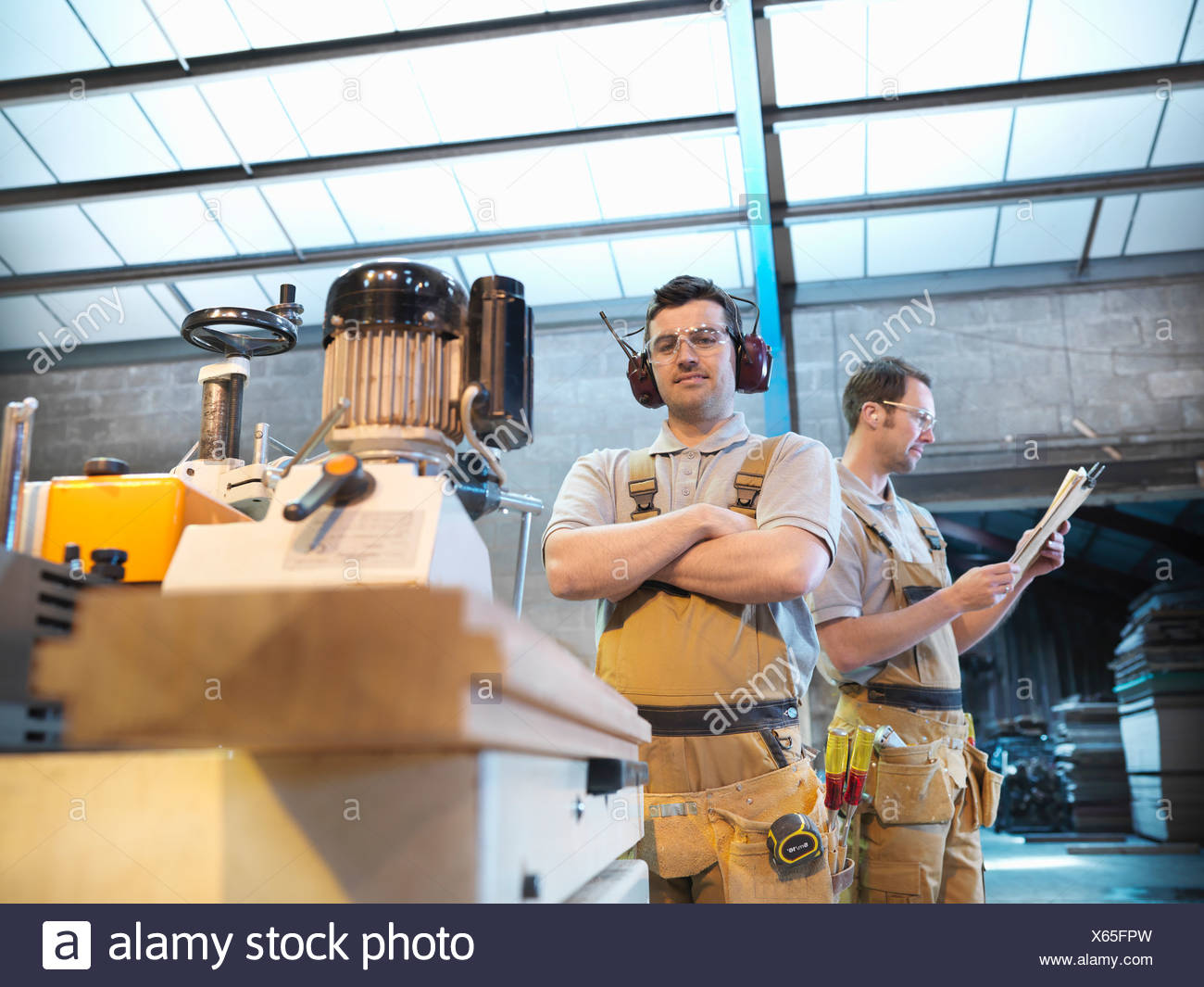 Woodworkers with woodwork machine - Stock Image