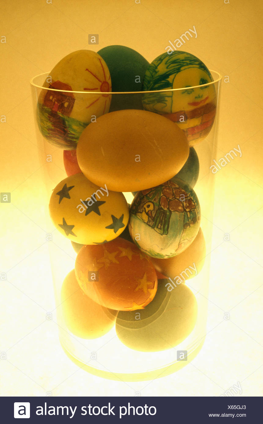Close Up Of Glass Jar Of Blown Eggs Decorated For Easter