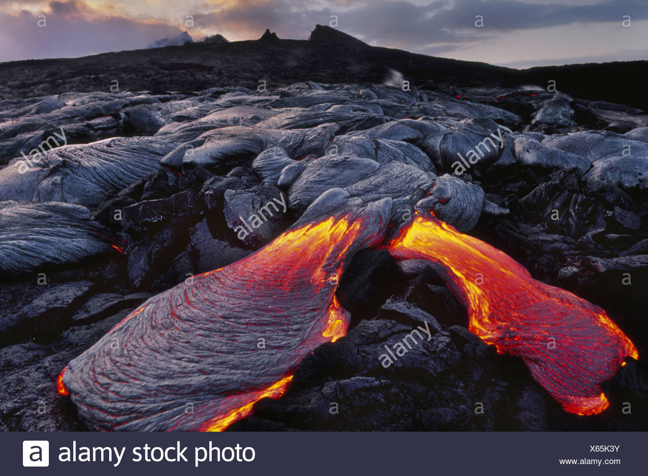 Flowing lava Hawaii Volcanoes National Park Hawaii Hawaii Volcanoes National Park Hawaii - Stock Image