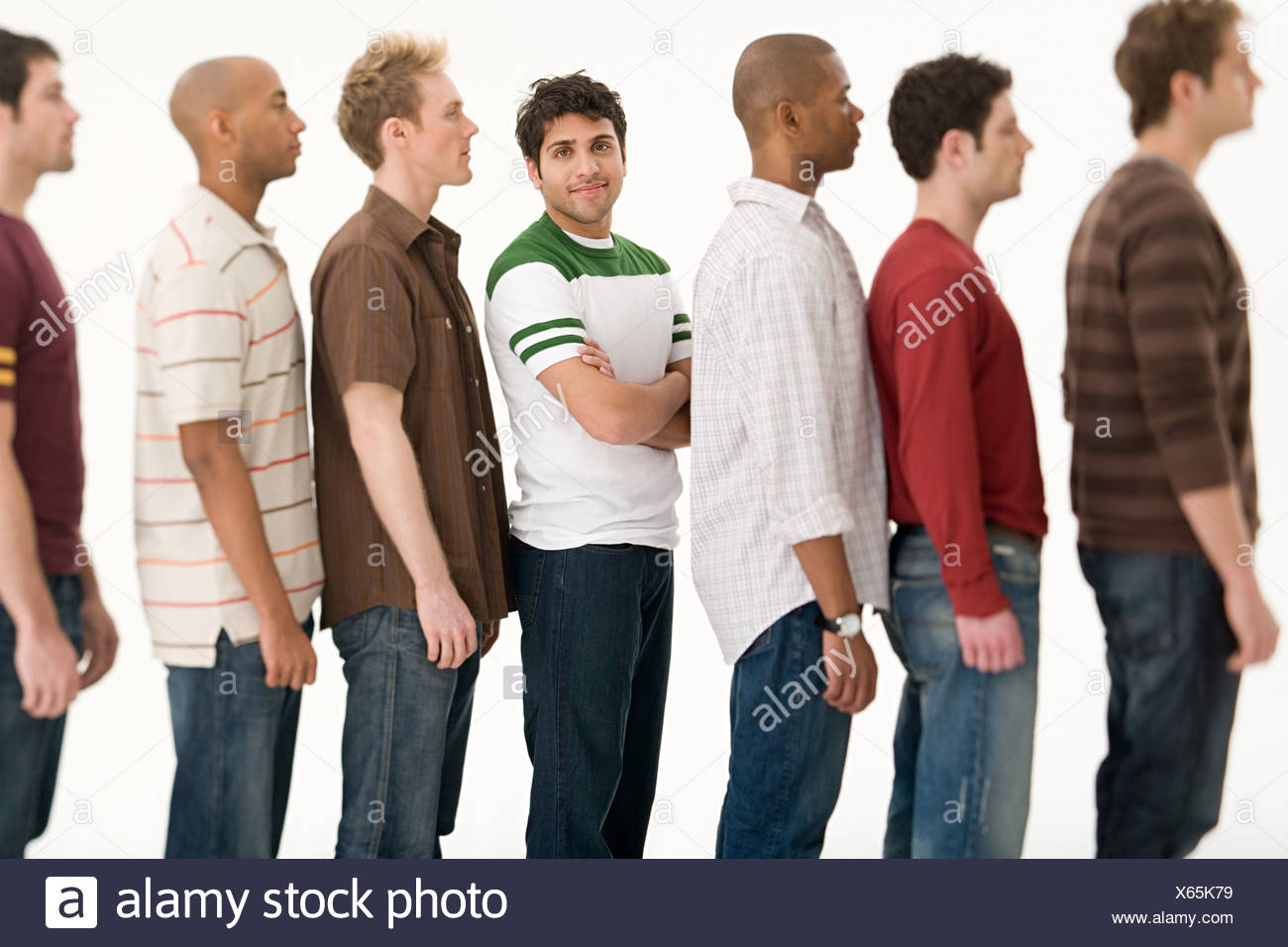 Young man in a row of men - Stock Image