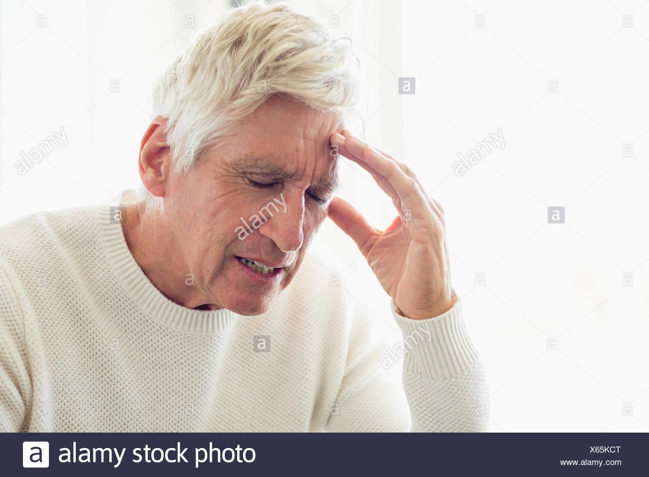 Senior man suffering from headache - Stock Image