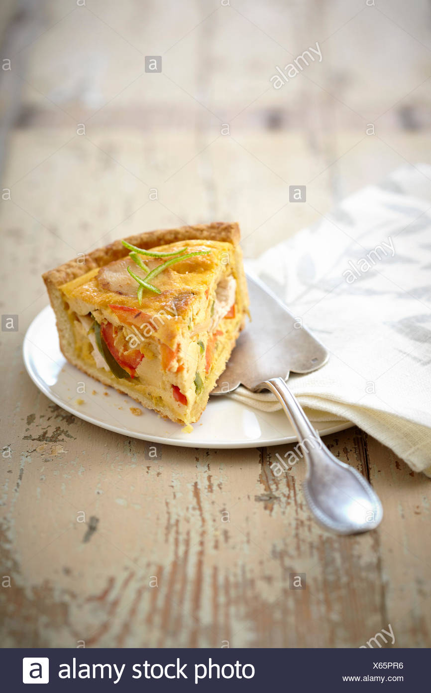 Slice of chicken and pepper savory tart - Stock Image