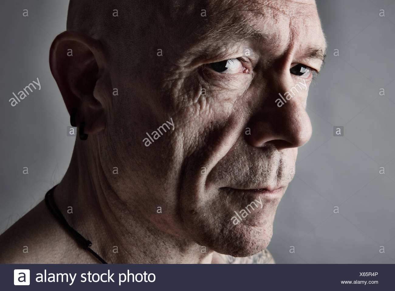 Portrait of sceptical looking man with bald - Stock Image