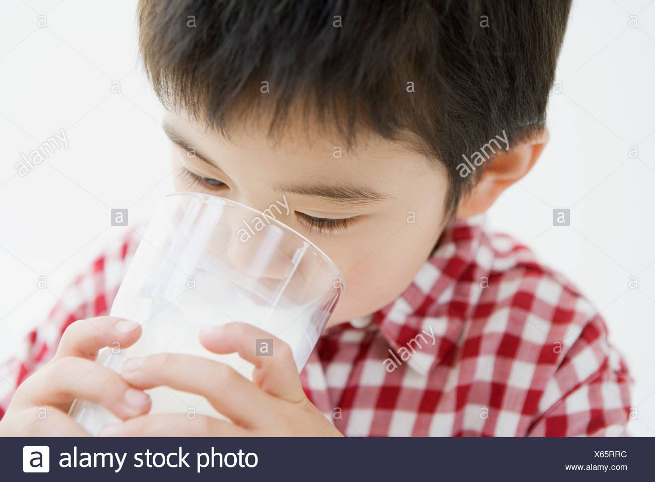Asian boy drinking milk Stock Photo