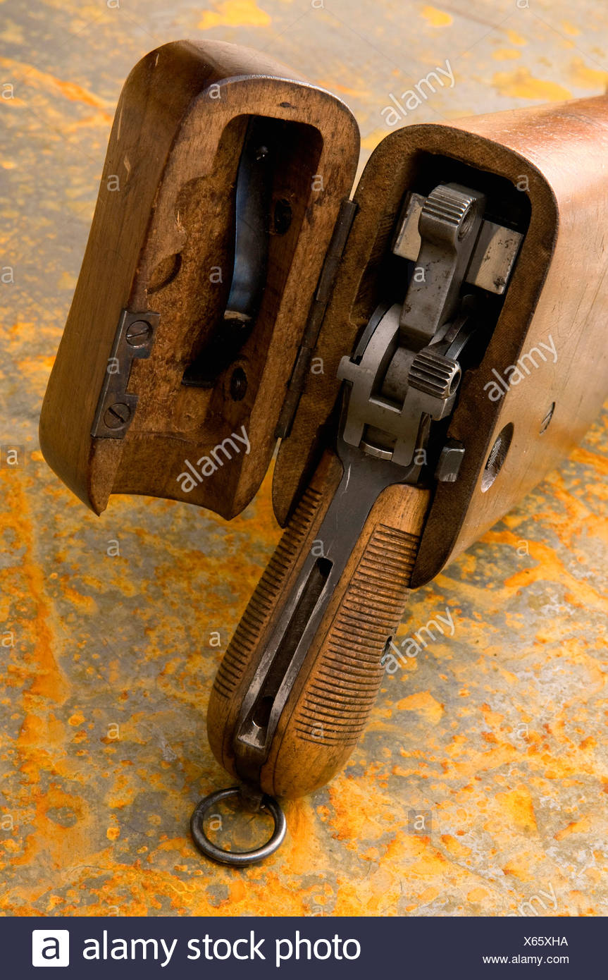 Antique pistol on rusty sheet, elevated view - Stock Image