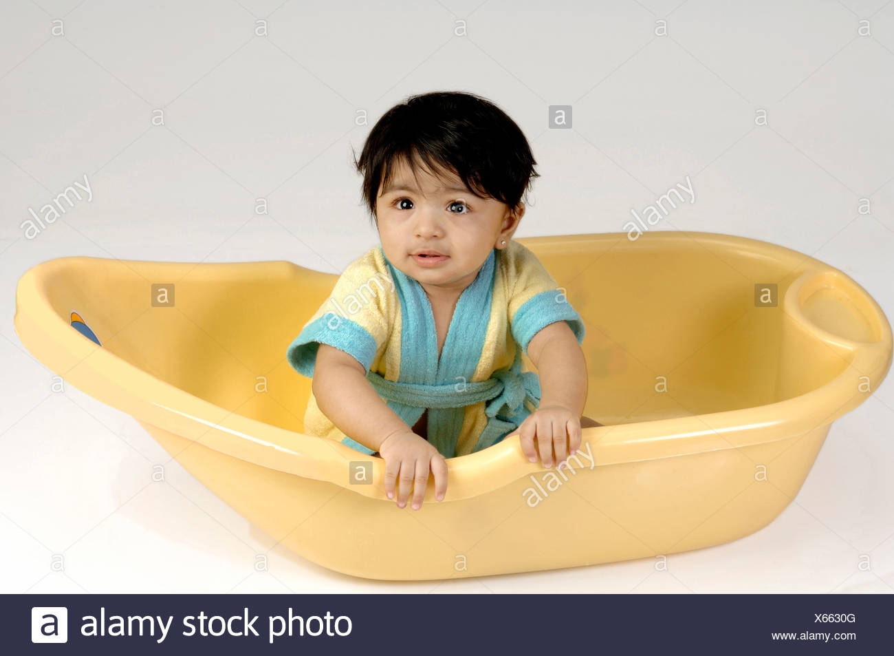 Indian Baby playing in yellow bath tub ; MR Stock Photo: 279187904 ...