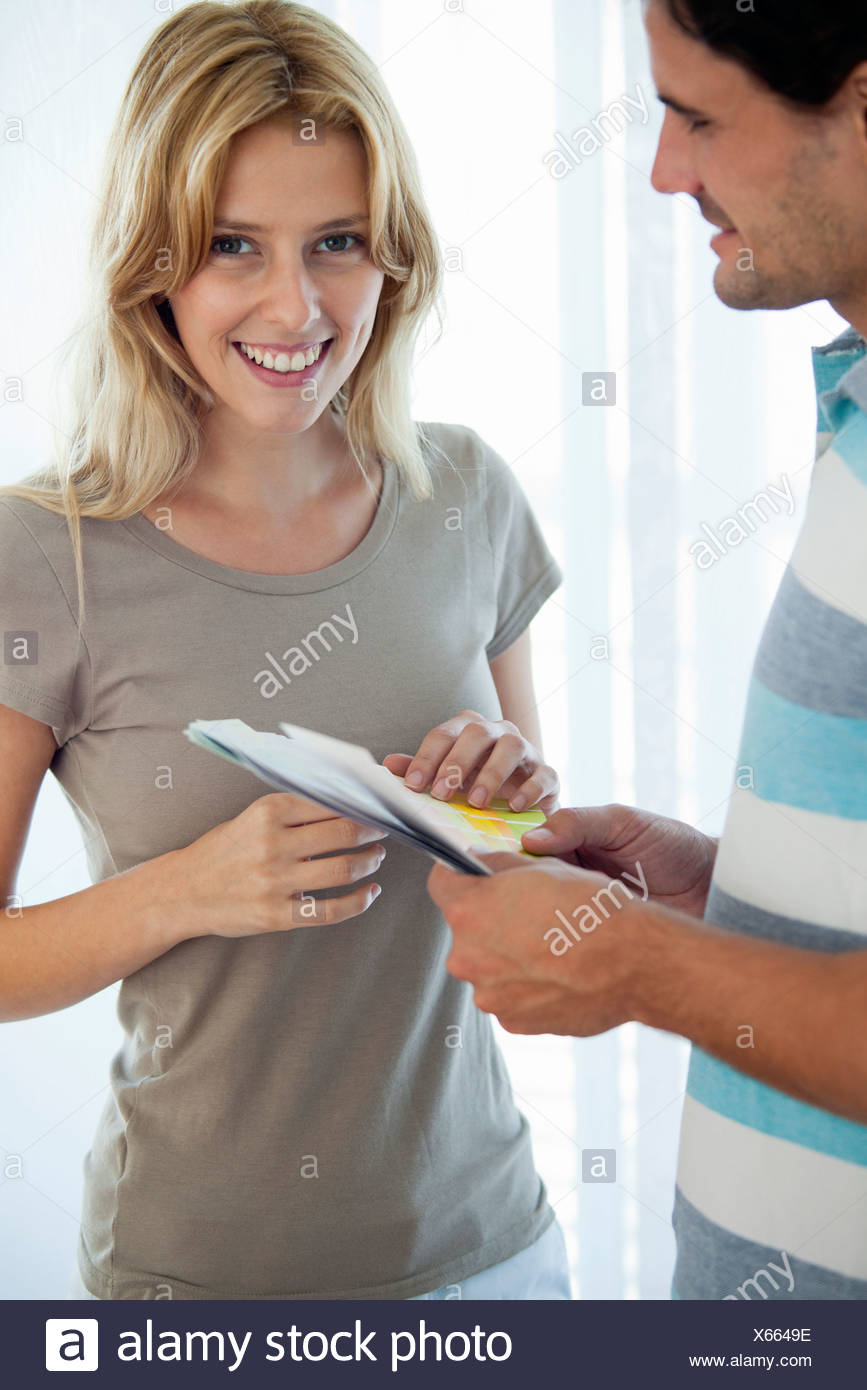 Couple discussing color swatches - Stock Image