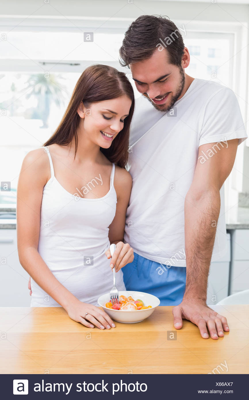Young couple having a healthy breakfast - Stock Image