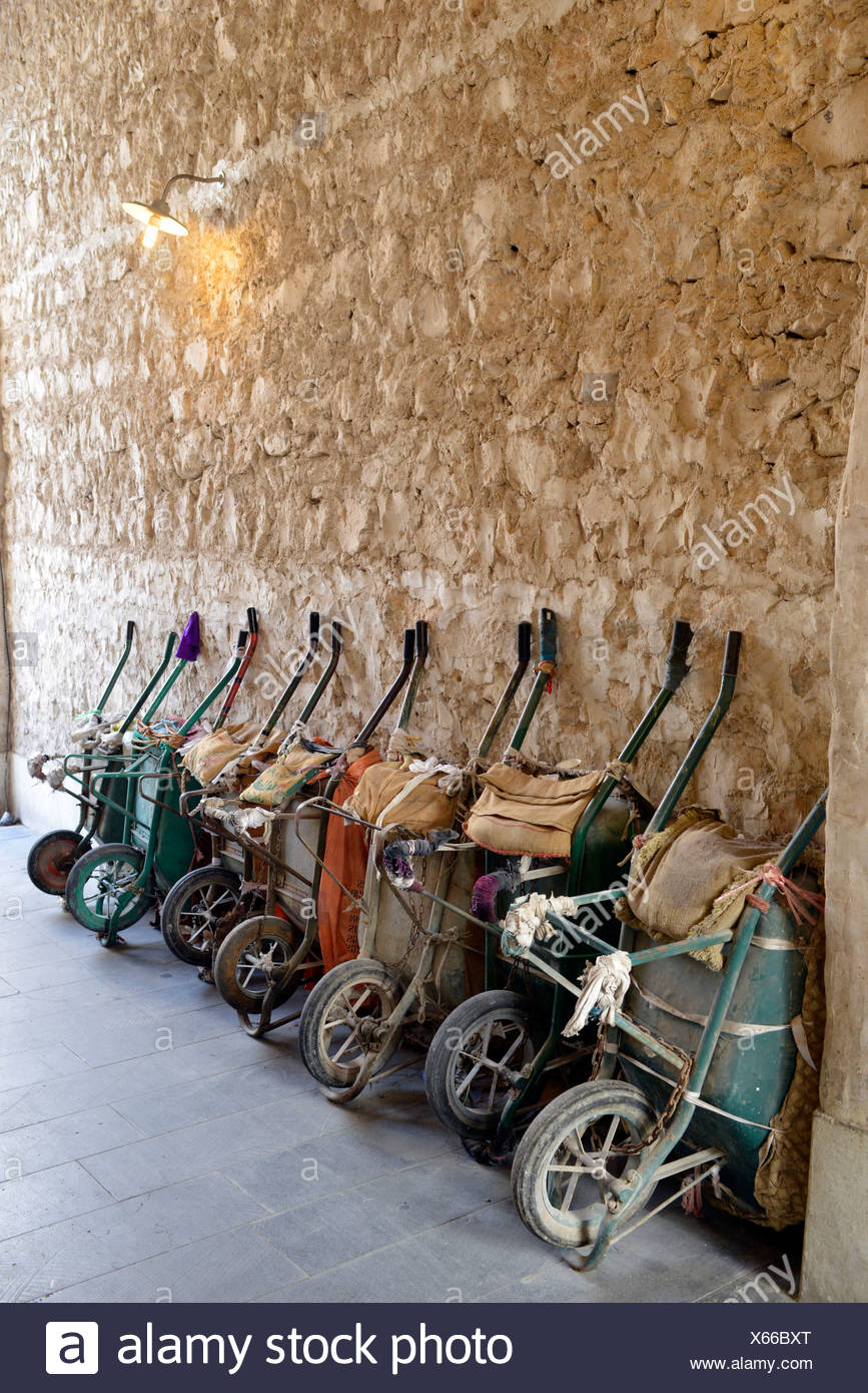 Parking for wheelbarrows, push carts, principal means of transportation in the Souq al Waqif, oldest souq or bazaar in the - Stock Image