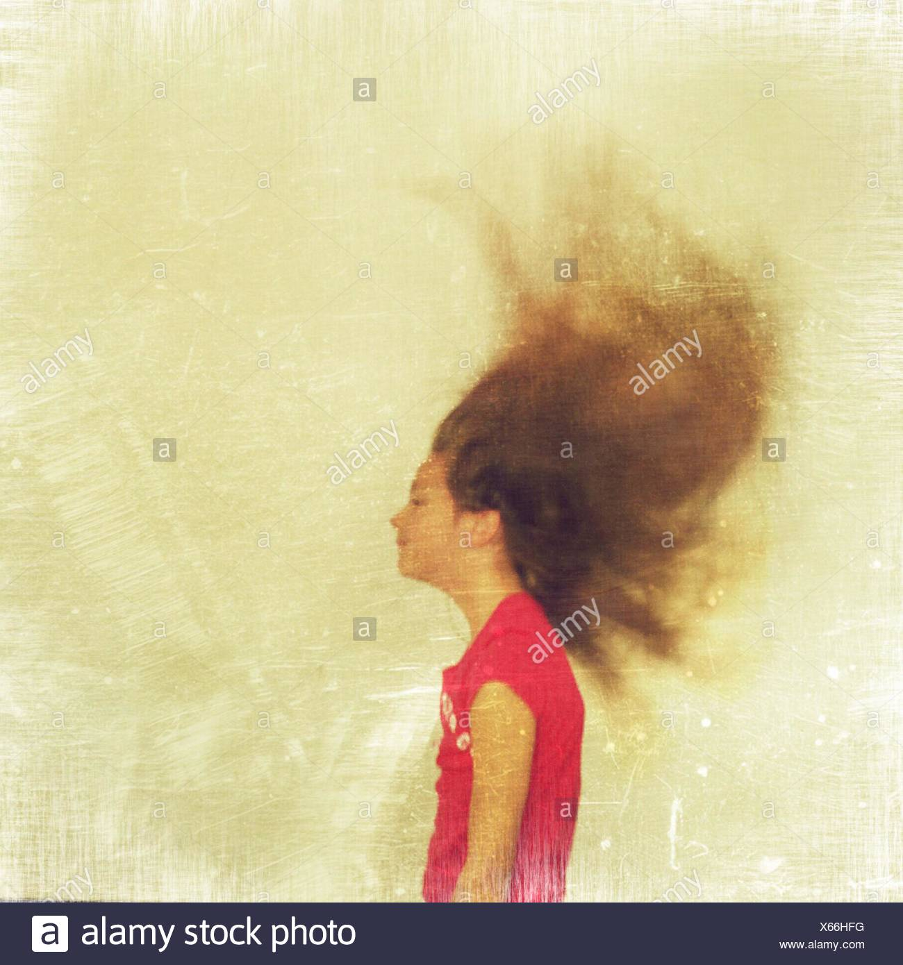 Side View Of Girl With Tousled Hair - Stock Image