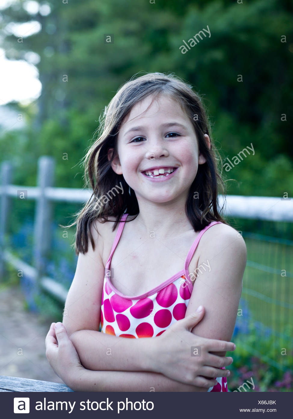 a happy girl in her bathing suit Stock Photo