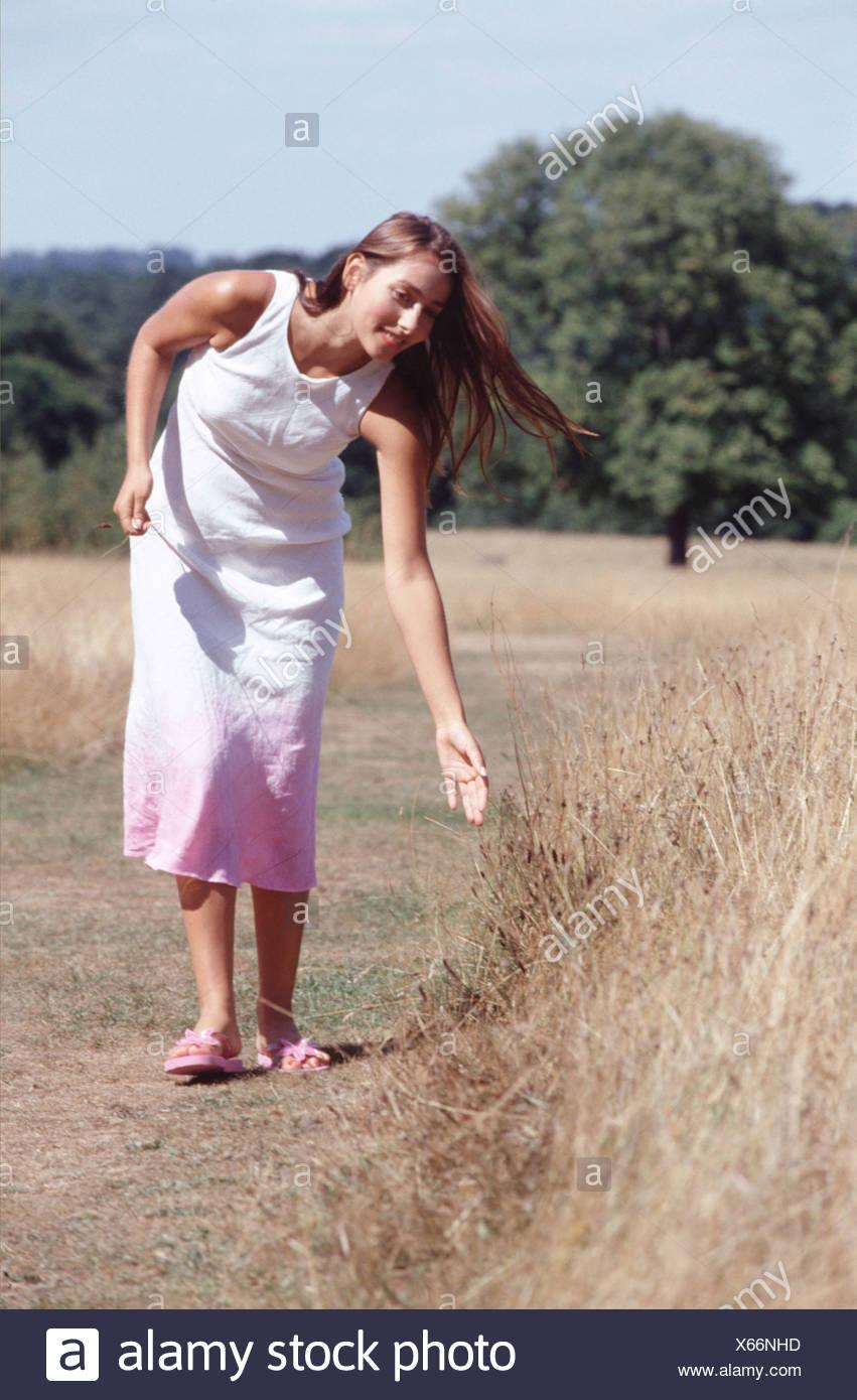 83766bf4e Female long brunette hair wearing white dress pink at bottom and pink flip  flops