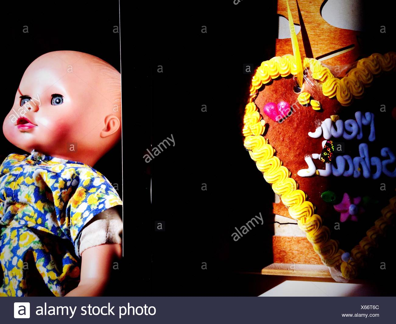 Close-Up Of A Doll Over Black Background - Stock Image
