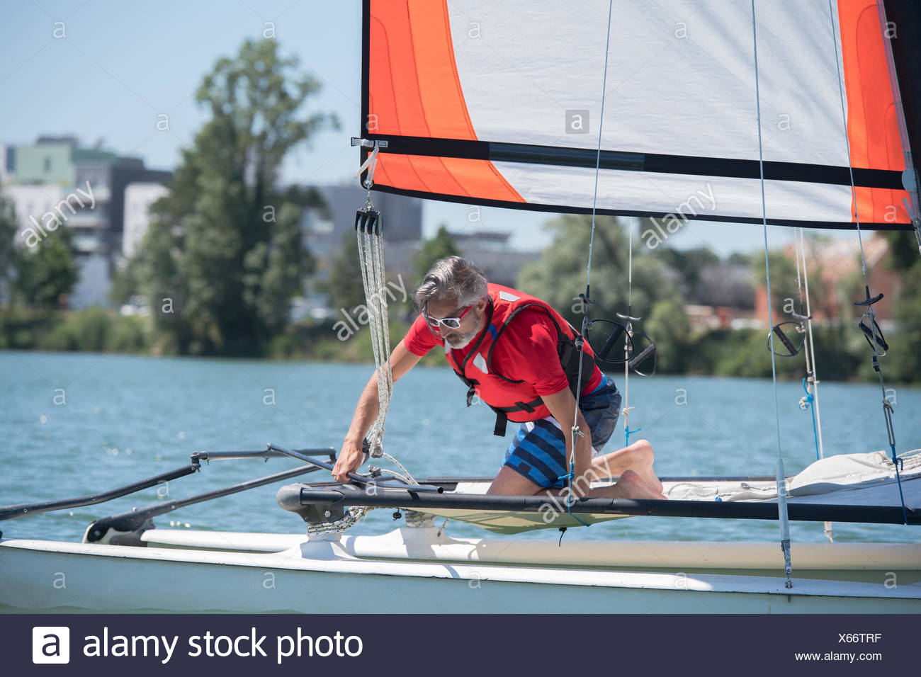 man on a saling boat - Stock Image