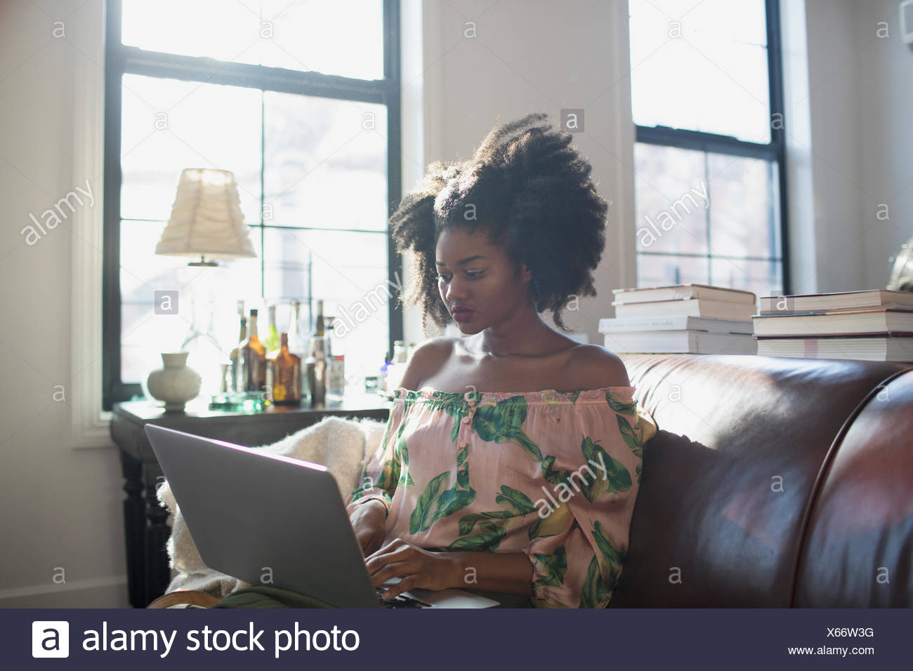 A young woman with a laptop - Stock Image