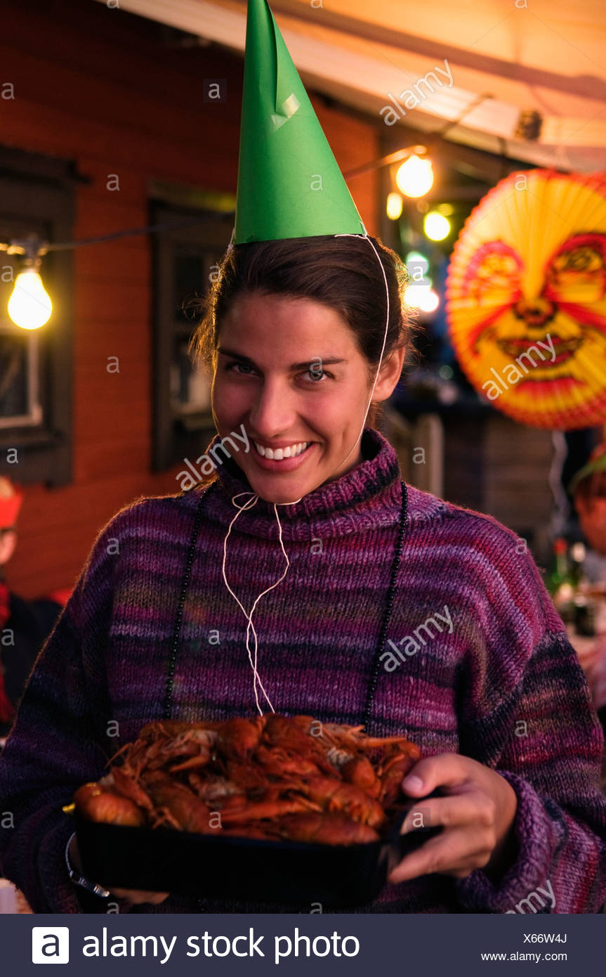 Woman in hat on crayfish party - Stock Image