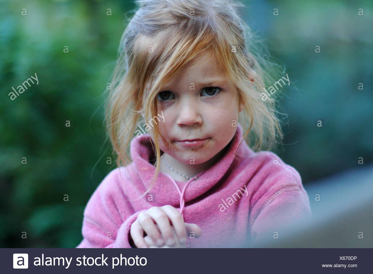 Wild girl with tousled disheveled hair - Stock Image