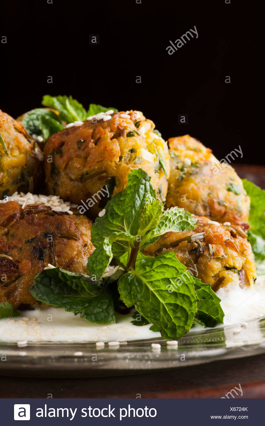 Falafel ball, a deep-fried ball or patty made from ground chickpeas, a traditional Middle Eastern food - Stock Image