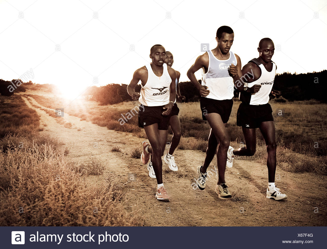 Kenyan marathon runners at sunset - Stock Image