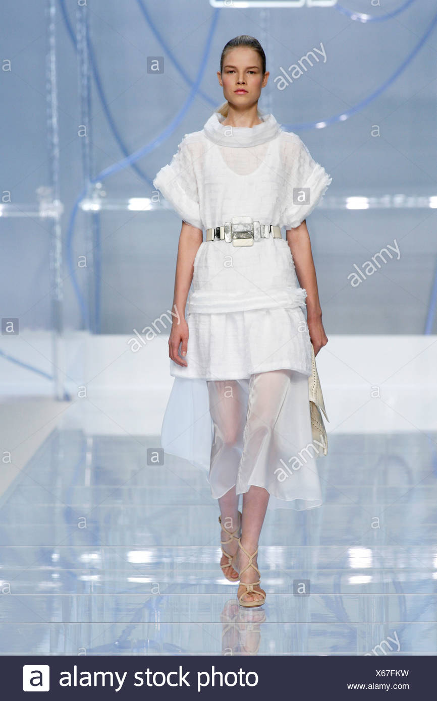 59d885fab06 Fendi Milan Ready to Wear Spring Summer Brunette female model hair scraped  back wearing a white