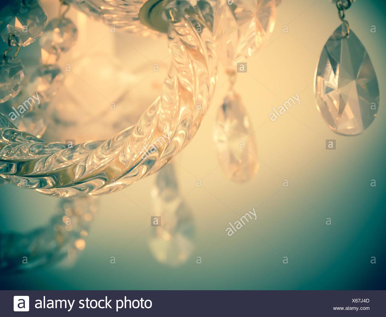 Quiet room chandelier,cross processed colors. - Stock Image