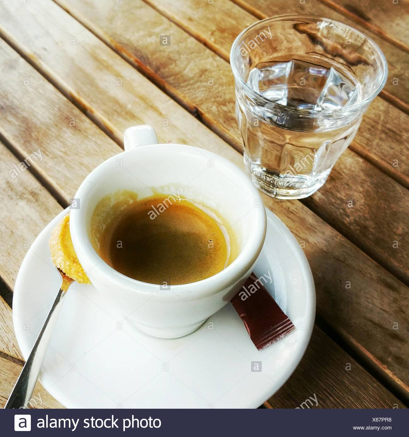 High Angle View Of Espresso Coffee With Water On Table - Stock Image