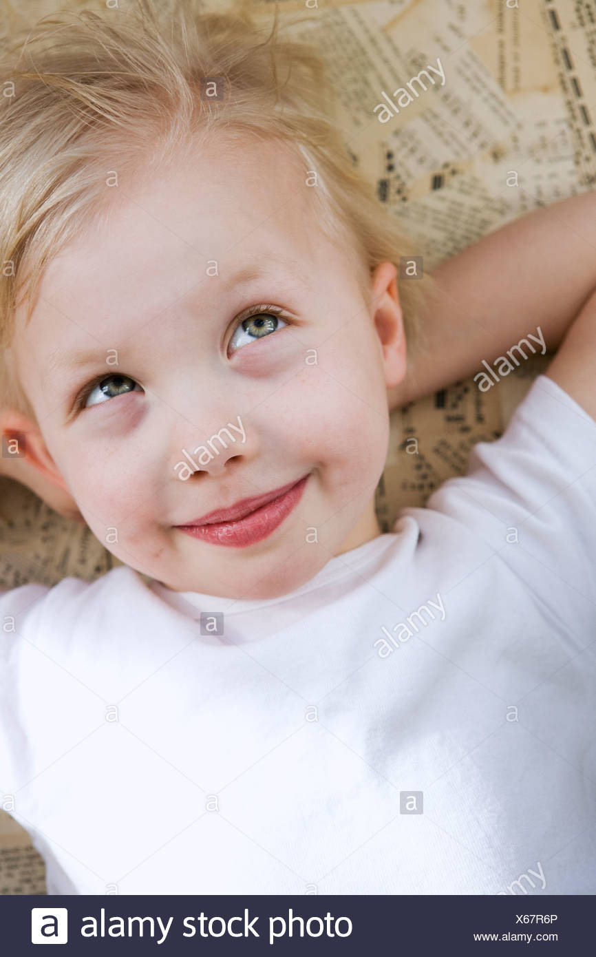 Smiling girl looking away - Stock Image