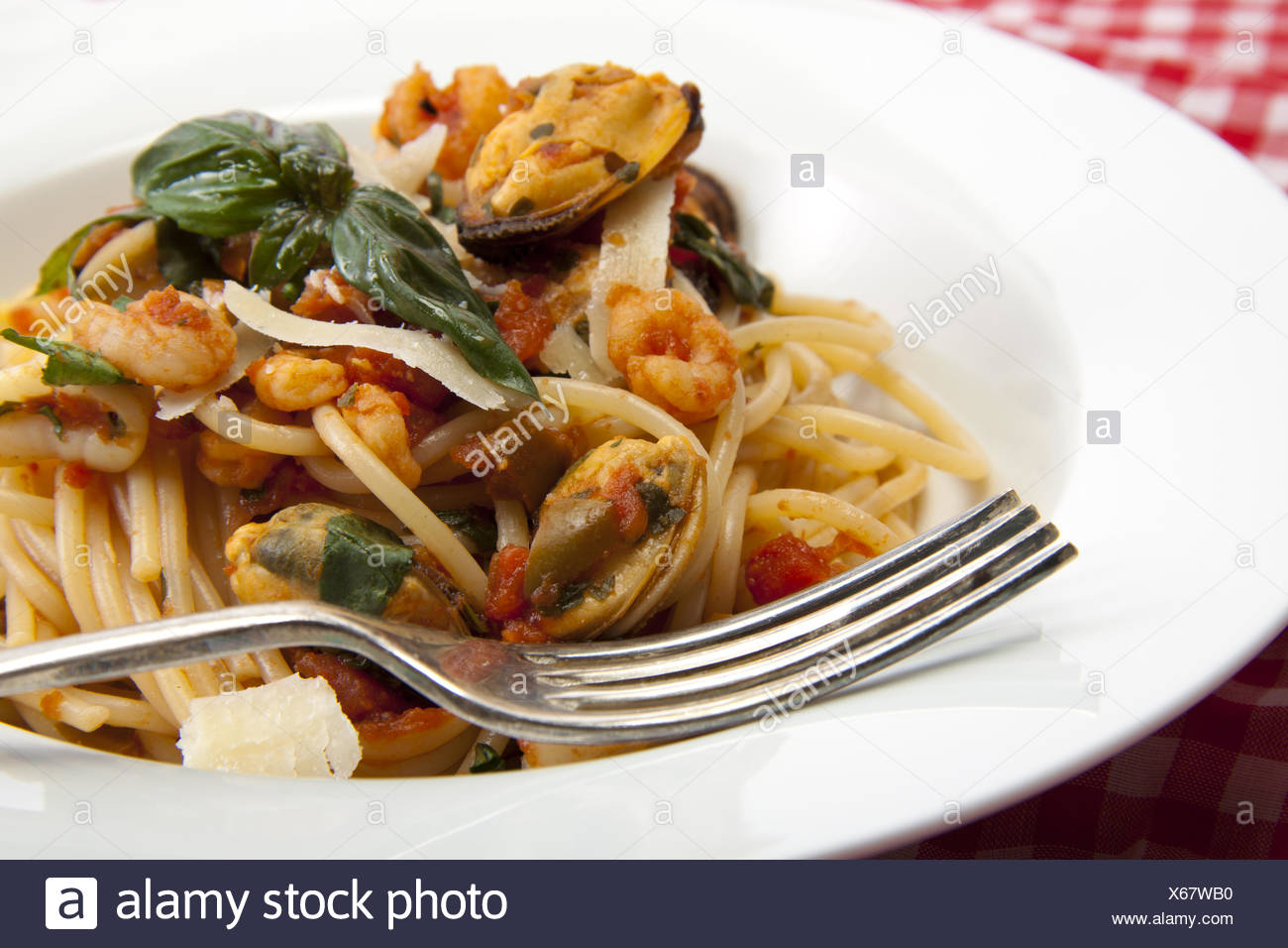 Spaghetti with a tomato and seafood souse - Stock Image