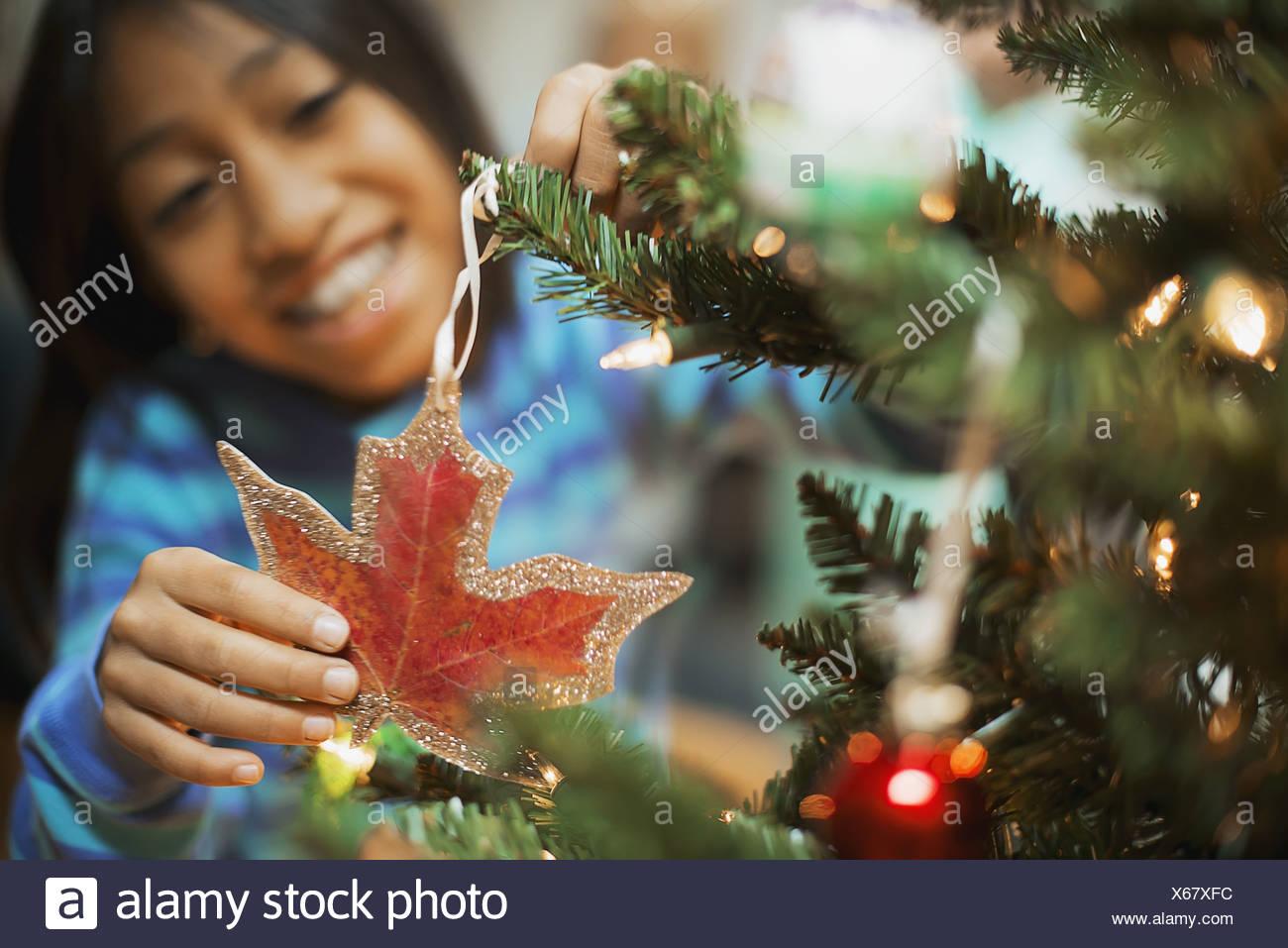 Woodstock New York USA young girl placing handmade Christmas ornament - Stock Image