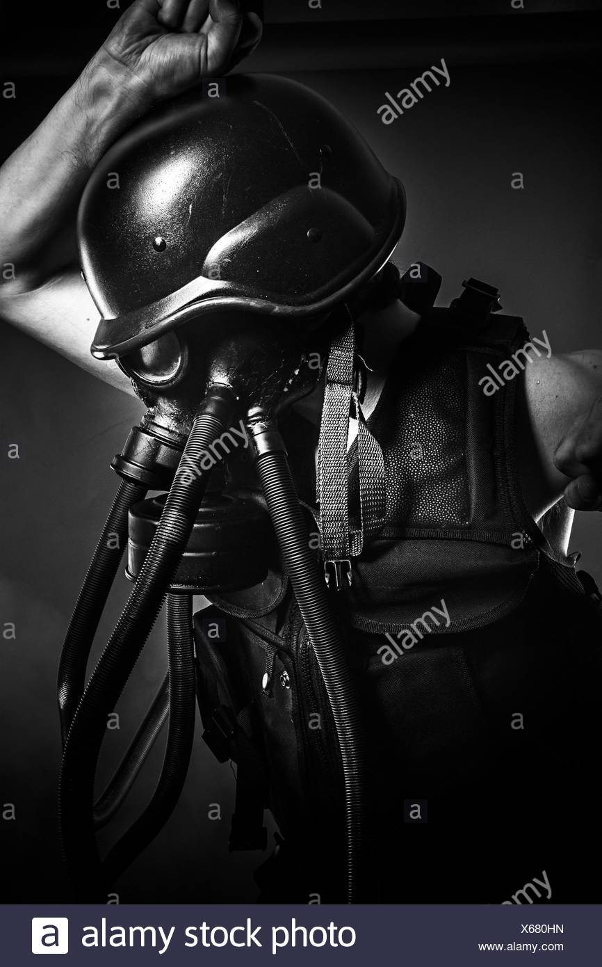 Army, nuclear disaster, man with gas mask, protection - Stock Image