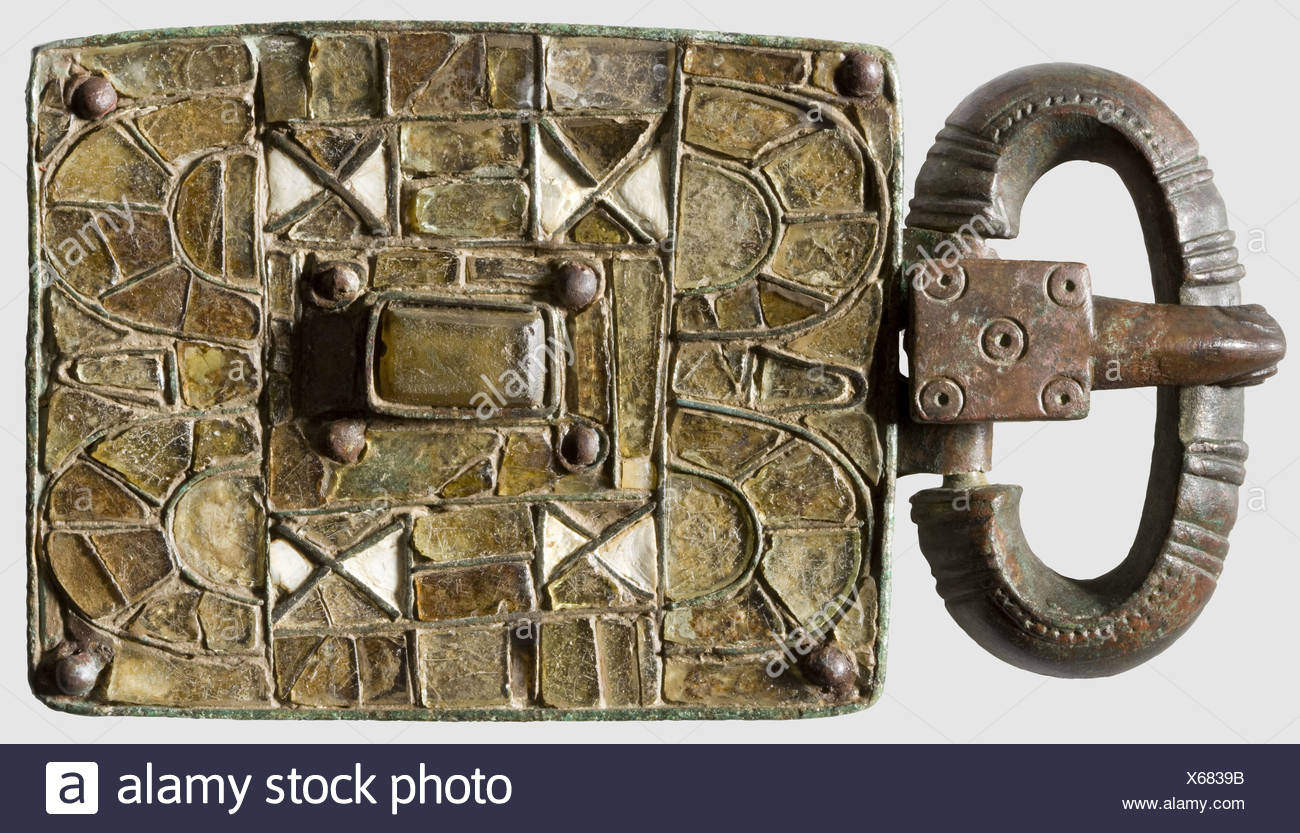 A Visigothic ceremonial belt buckle, 5th - 6th century A.D. Rectangular belt plate, bronze with greenish patina. The front profusely embellished with polychrome glass inlays. Oval buckle with grooved pattern, the pin in the shape of a stylised eagle's head. Cleaned archaeological find. Length 13.8 cm, historic, historical, ancient world, ancient world, ancient times, object, objects, stills, clipping, cut out, cut-out, cut-outs, Additional-Rights-Clearences-NA - Stock Image