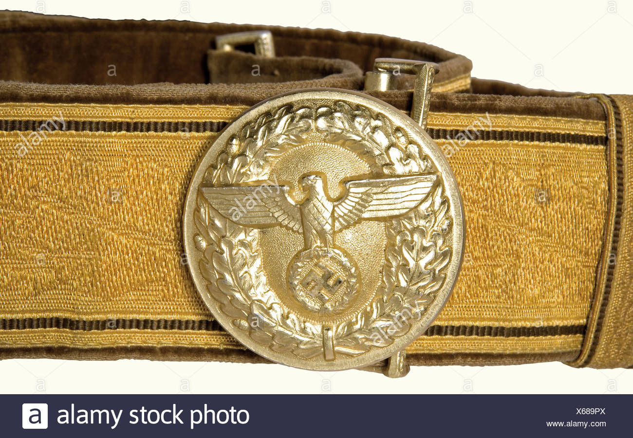 A parade belt for a Political Leader., Gold-coloured cello version with oak leaf decoration, brown velvet backing, golden anodized buckle (diameter 50 mm, manufacturer 'M4/24') and catch. Shortened. One of the two slides is missing, two small holes.' historic, historical, 1930s, 1930s, 20th century, party organisation, party organization, organisations, organizations, organization, organisation, party, parties, political party, German, Germany, NS, National Socialism, Nazism, Third Reich, German Reich, utensil, piece of equipment, utensils, object, objects, sti, Additional-Rights-Clearances-NA - Stock Image