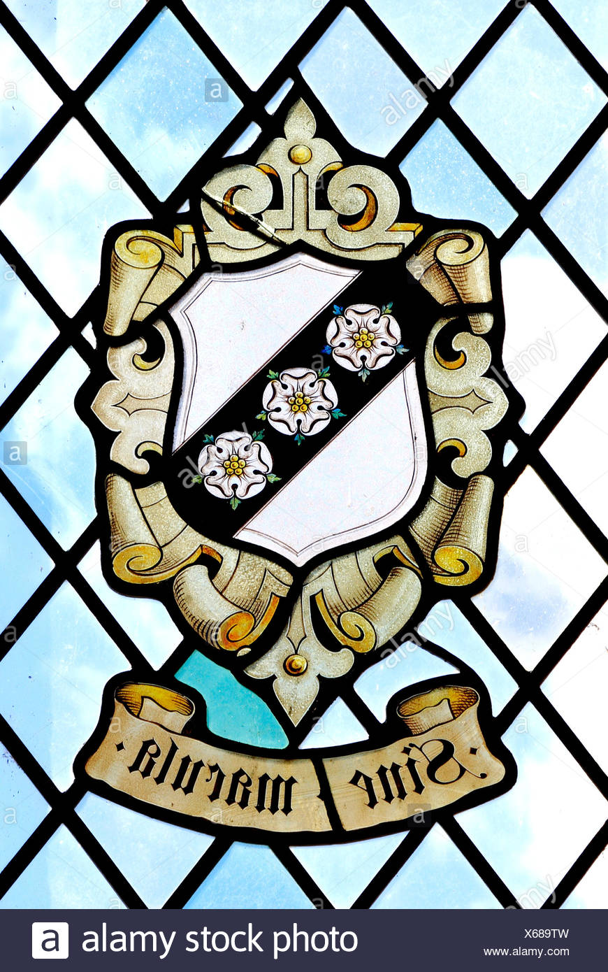 Sine Macula, Without Blemish, Without Stain, heraldic, heraldry, stained glass window of the Carey Family, East Barsham Manor, Norfolk, England, UK - Stock Image