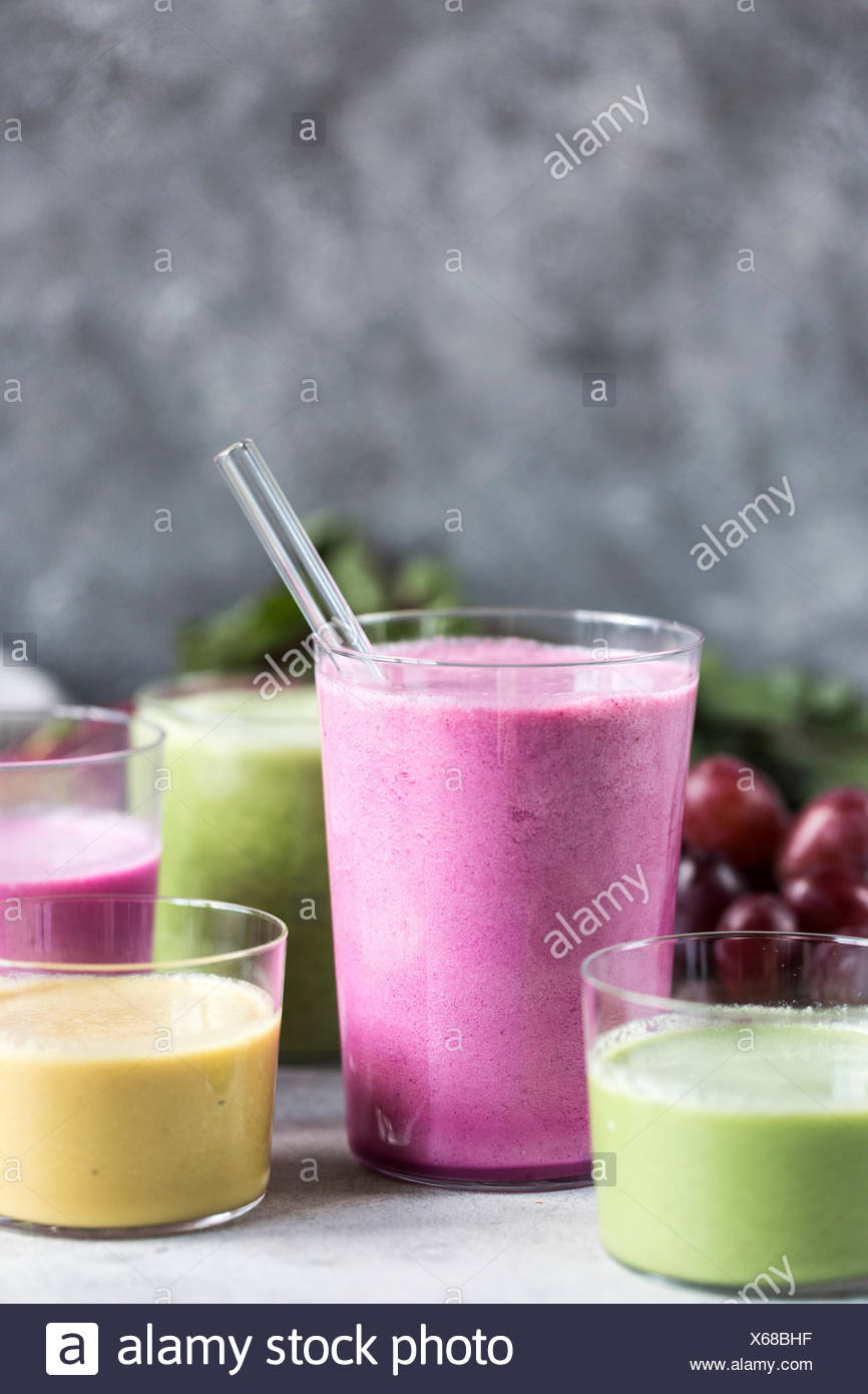 Several glasses of Multi-Colored Beet Smoothies are photographed from the front view. Stock Photo