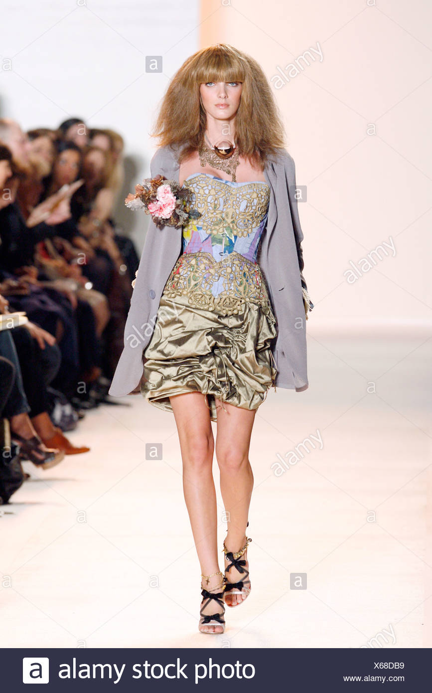 af50532f52 Christian Lacroix Paris Ready to Wear Spring Summer Model wearing a gold  gathered satin skirt a