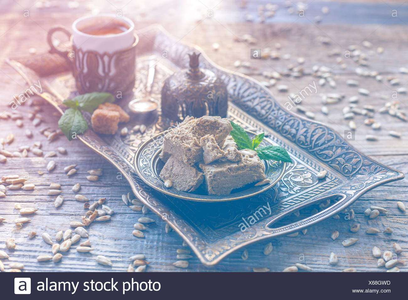 Halva and a cup of black coffee. - Stock Image