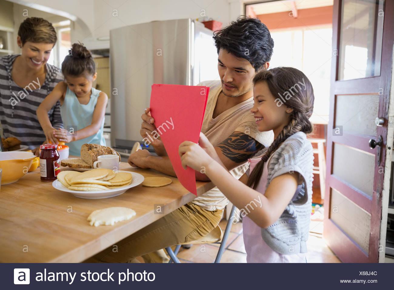 Family enjoying breakfast in kitchen - Stock Image